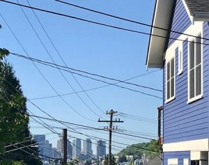 Photo of house showing how overhead wires clutter the sky