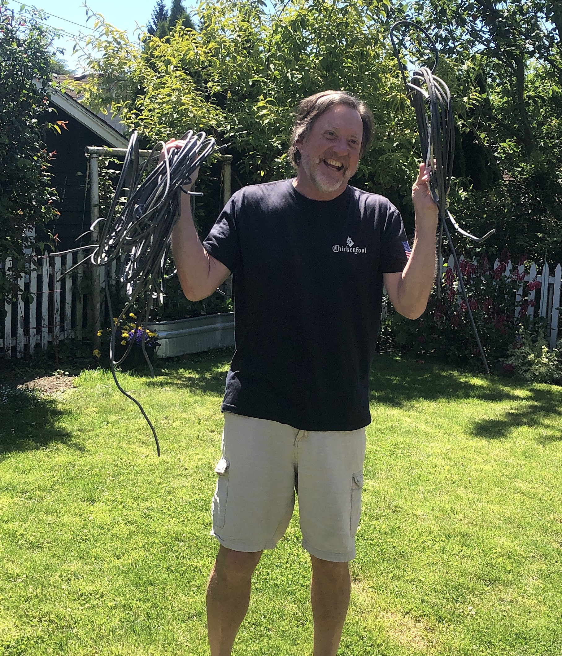 Man holding coil of wires we removed from his home