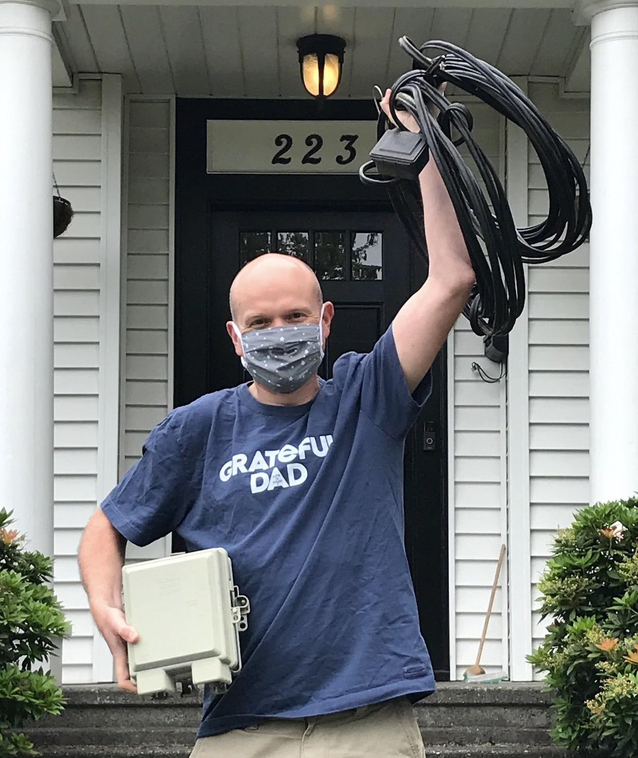 closeup of a man holding coil of wires we removed from his home