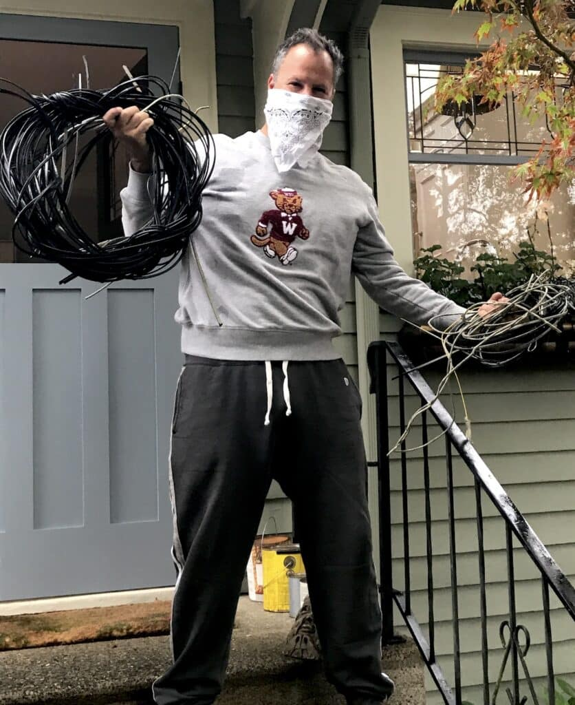 Photo of a man with the many wires removed from house