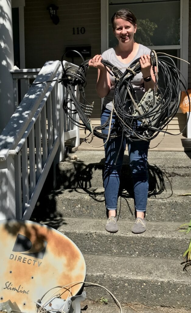 Photo of a woman with the many wires and satellite dish removed from house