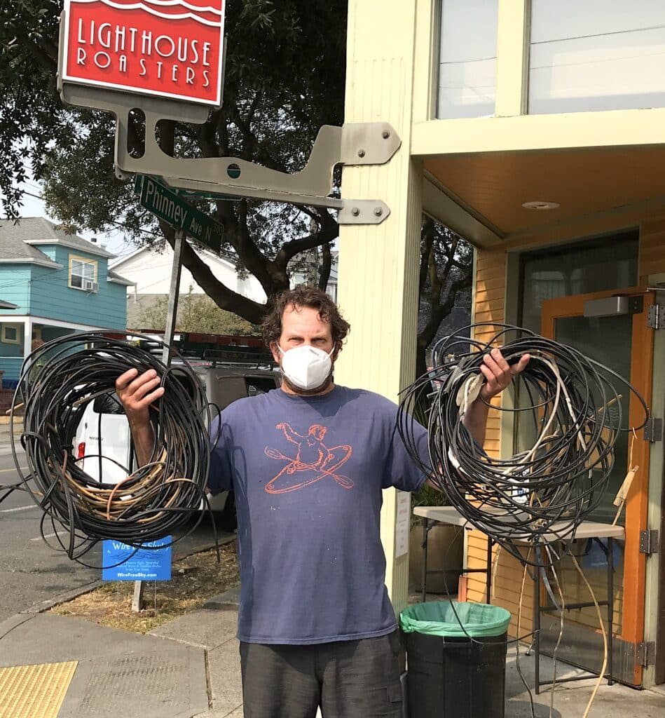 Photo of a man with the many wires removed from Lighthouse coffeeshop